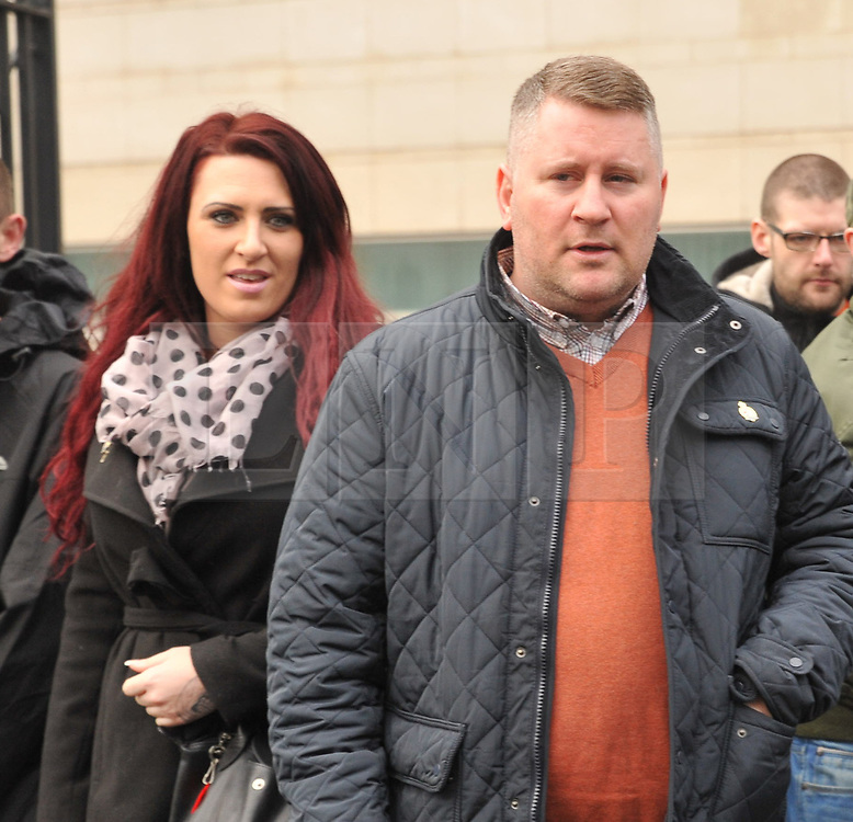 """© Licensed to London News Pictures. 10/1/2018. Belfast, UK. Britain First's leader Paul Golding (R) with deputy leader Jayda Fransen seen leaving court after making his first appearance after being charged with using """"threatening, abusive, insulting words or behaviour"""" following a speech he gave at a rally organised by Independent Belfast City Councillor Jolene Bunting last year. Ms Fransen has been criticised after appearing in a video showing her sitting in robes in the Lord Mayor's chair inside Belfast City Hall. The council are investigating.   Photo credit: John Rymer/LNP"""