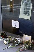Brussels Belgium 6th December 2013. At the South African Embassy in Brussels people gather, Nelson Mandela died just yesterday.The portrait of Mandela  and flowers outside. Text says madiba you will never be forgotten