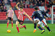 Luke O'Nien (#13) of Sunderland AFC runs past James Justin (#2) of Luton Town FC during the EFL Sky Bet League 1 match between Sunderland AFC and Luton Town at the Stadium Of Light, Sunderland, England on 12 January 2019.