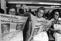 "August 1974, Virginia, USA --- Women at Washington National Airport read copies of the  newspaper with ""Nixon Resigning"" as the headline on the front cover. --- Image by © Owen Franken/CORBIS"