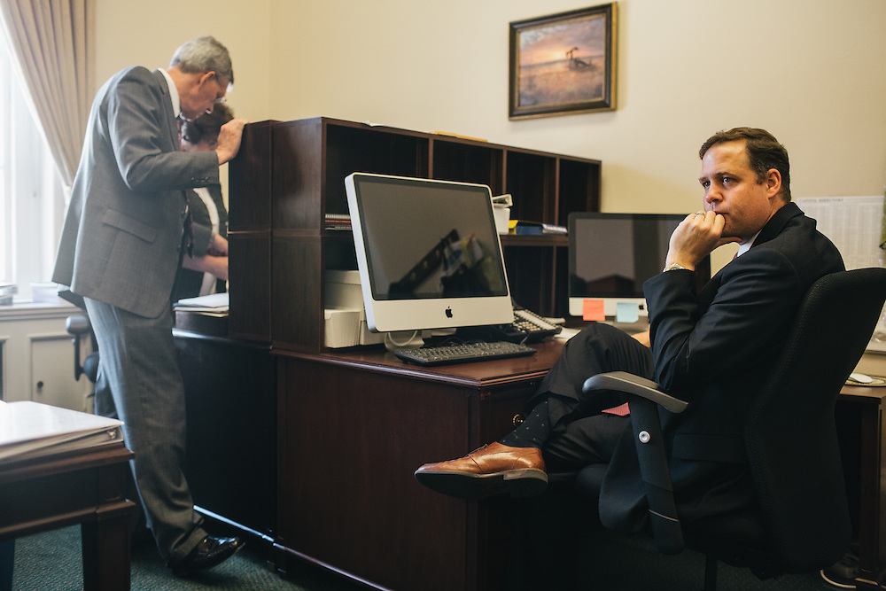 Congressman Jim Bridenstine goes over his schedule in his office in the Cannon House Office Building with staffers on Sept. 19, 2013.