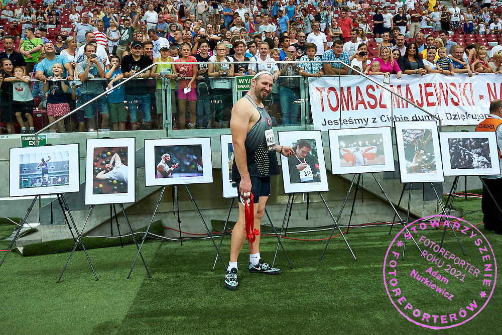 Warsaw, Poland - 2016 August 28: Tomasz Majewski poses with Photo Exhibition of Tomasz Majewski during athletics meeting Kamila Skolimowska Memorial 2016 at PGE National Stadium  August 28, 2016 w Warsaw, Poland.<br /> <br /> Adam Nurkiewicz declares that he has no rights to the image of people at the photographs of his authorship.<br /> <br /> Picture also available in RAW (NEF) or TIFF format on special request.<br /> <br /> Any editorial, commercial or promotional use requires written permission from the author of image.<br /> <br /> Mandatory credit:<br /> Photo by &copy; Adam Nurkiewicz