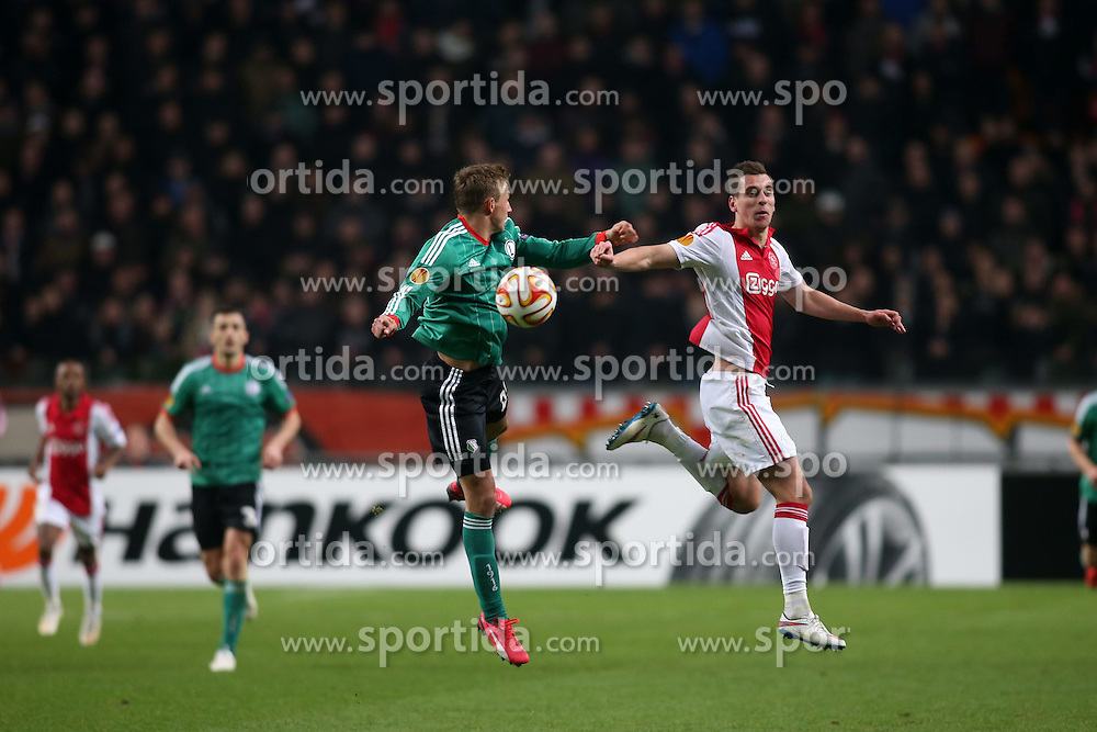 19.02.2015, Pepsi Arena, Warschau, POL, UEFA EL, Legia Warschau vs Ajax Amsterdam, 1. Runde, Hinspiel, im Bild JAKUB RZEZNICZAK ARKADIUSZ MILIK // during the UEFA Europa League 1st Round, 1st Leg match between Legia Warschau and Ajax Amsterdam at the Pepsi Arena in Warschau, Poland on 2015/02/19. EXPA Pictures &copy; 2015, PhotoCredit: EXPA/ Newspix/ Piotr Kucza<br /> <br /> *****ATTENTION - for AUT, SLO, CRO, SRB, BIH, MAZ, TUR, SUI, SWE only*****