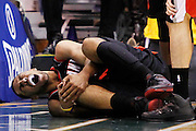 Portland Trail Blazers forward Jeff Pendergraph, grimaces in pain after getting injured in the first half of their NBA preseason basketball game against the Utah Jazz in Salt Lake City, Thursday, Oct. 7, 2010. (AP Photo/Colin E Braley)