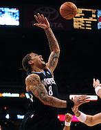 Apr. 11, 2011; Phoenix, AZ, USA; Minnesota Timberwolves forward Michael Beasley (8) puts up a shot against the Phoenix Suns at the US Airways Center. Mandatory Credit: Jennifer Stewart-US PRESSWIRE