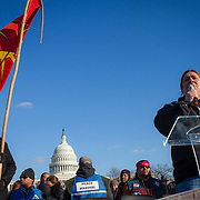 Corey Peltier speaks about his father, Leonard Peltier, during a protest and march from in front of the U.S. Capitol to the EPA, about the North Dakota Access Pipeline, as well as the effort to free Leonard Peltier.  Peltier along with many other family members and friends spoke about the effort to free Leonard Peltier, whom they claim is a political prisoner implicated and imprisoned following the death of two FBI agents during a shootout on the Pine Ridge reservation in 1975.  Saturday, December 10, 2016. John Boal Photography