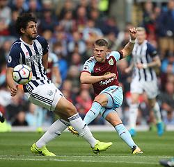 Johann Gudmundsson of Burnley (R) has a shot on goal - Mandatory by-line: Jack Phillips/JMP - 19/08/2017 - FOOTBALL - Turf Moor - Burnley, England - Burnley v West Bromwich Albion - Premier League