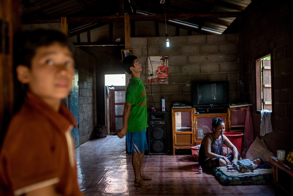 A family home in the the village of Khoc Khom. The family powers several small lights with a homemade water turbine. The village is not connected to the main electrical grid and many residents operate their own turbines to power lights and sometimes small appliances.