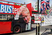 On the day that Britain's new Conservative Party Prime Minister, Boris Johnson enters Downing Street to begin his government administration, replacing Theresa May after her failed Brexit negotiations with the European Union in Brussels, a bus tours parliament Square with a hashtag about Johnson's reputation of an economy with the truth, on 24th July 2019, in Westminster, London, England.