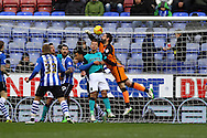 Wigan Athletic Goalkeeper Scott Carson punches the ball clear as Blackburn press for a goal. Skybet football league championship match , Wigan Athletic v Blackburn Rovers at the DW Stadium in Wigan, Lancs on Saturday 17th Jan 2015.<br /> pic by Chris Stading, Andrew Orchard sports photography.