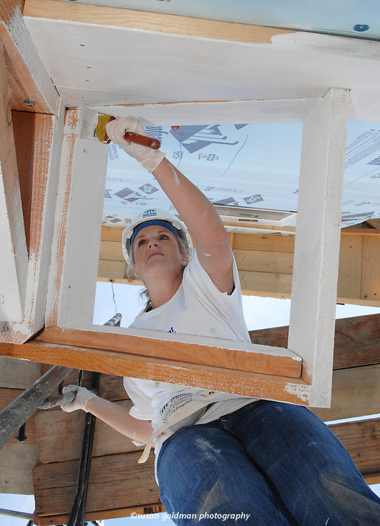 Country singer Trisha Yearwood lends a hand painting a new home with Habitat for Humanity, in San Pedro, Calif. As part of the Jimmy Carter Work Project, now in its 24th year, 100 houses will be built or rehabilitated in Los Angeles by the end of the year, to help low-income families realize the dream of home ownership. Photo/Habitat for Humanity, Susan Goldman.