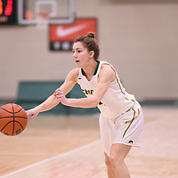 3rd year guard Avery Pearce (4) of the Regina Cougars in action during the Women's Basketball Playoff Game on February  15 at Centre for Kinesiology, Health and Sport. Credit: Arthur Ward/Arthur Images