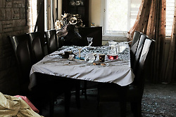 May 5, 2019 - Ashkelon, Israel - Damage, debris and a sense of chaos in the dining room at the home of Moshe Agadi, 58, married and father of four, Israel's first casualty in this round of hostilities after being critically injured by shrapnel in his chest and abdomen. One of over 600 rockets fired into Israel from the Hamas controlled Gaza Strip in less than 48 hours landed in the yard, killing Agadi and damaging two homes. (Credit Image: © Nir Alon/ZUMA Wire)