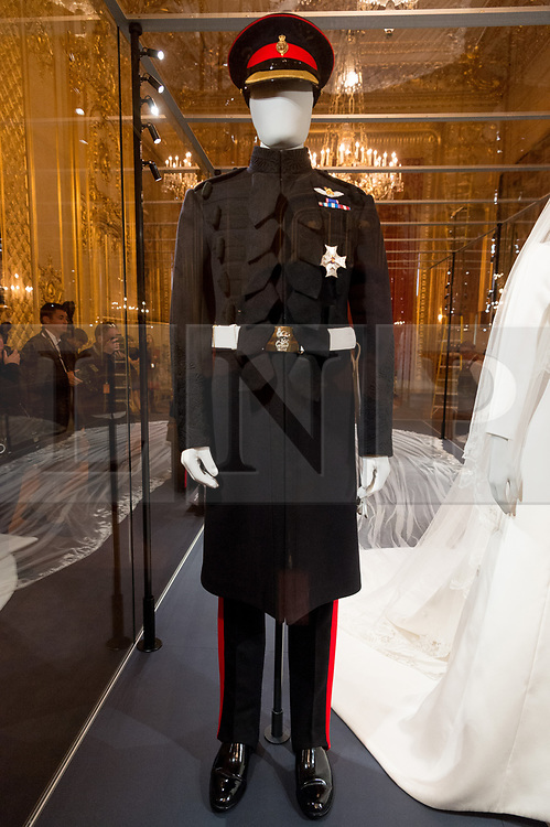 © Licensed to London News Pictures. 25/10/2018. Windsor, UK. The Duke of Sussex uniform is from the Household Cavalry(the Blues and Royals. The outfit is on display at The Royal Collection at Windsor Castle. PLEASE NOTE, THIS PHOTO IS EMBARGOED FOR PUBLICATION UNTIL 00:01 FRIDAY 26 OCTOBER 2018. Photo credit: Ray Tang/LNP