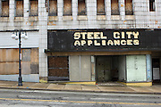 An old appliance store is just one of many abandoned buildings in the distressed steel town of Clairton, Pennsylvania.