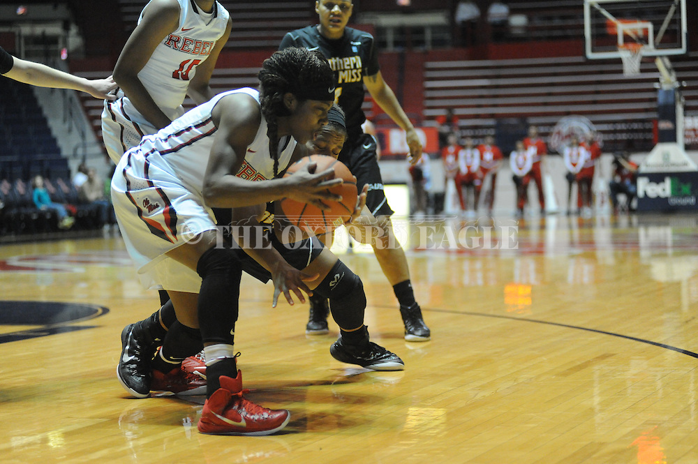 """Ole Miss Lady Rebels guard Erika Sisk (5) goes for a loose ball against Southern Mississippi Lady Golden Eagles guard Megan Brown (22) at the C.M. """"Tad"""" Smith Coliseum in Oxford, Miss. on Thursday, December 18, 2014. (AP Photo/Oxford Eagle, Bruce Newman)"""