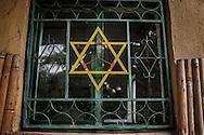 Symbols of peace frame a window at the Zion Train Lodge in Shashemene.  Ethiopia