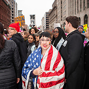 """Alicia Zen, traveled from New York City, with the flag of """"Mr. Hartstein"""" a Vietnam Veteran who recently died from cancer to participate in the Women's March on Washington where an anticipated 200,000 people turned into an estimated 500,000 to 1 million people, on Saturday, January 21, 2017.  When asked about her hopes for the next 4 years, Zen said she hopes, """"...we still move forward with progress...that we become more equal, tolerant and accepting of each other...""""  John Boal Photography"""