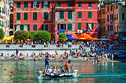 Water taxi and tourists on the beach at Vernazza, Cinque Terre, Liguria, Italy