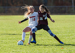 Belmont's Jasmine Shed battles with Derryfield's Kim Gosselin during a playoff game at Belmont on Wednesday, October 26, 2016.  (Alan MacRae/for the Laconia Daily Sun)