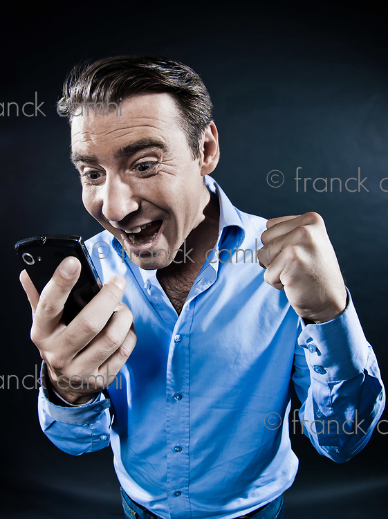 caucasian man telephone success portrait isolated studio on black background