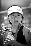 A young girl (Keiki) holds a water bottle after running in the Honolulu Keiki Marathon. Missoula Photographer