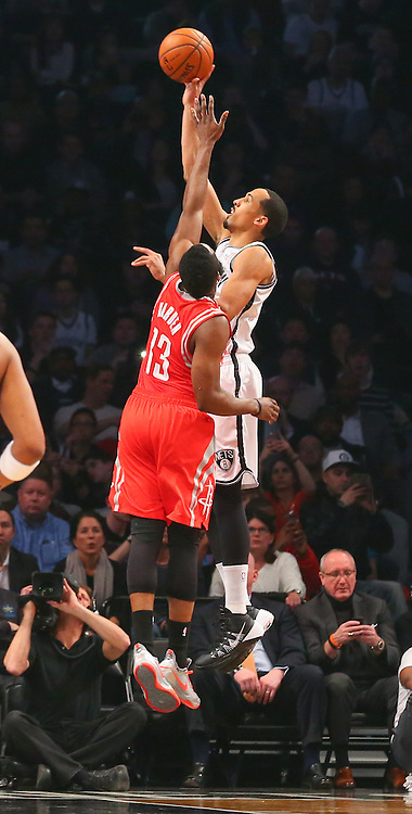 Apr 1, 2014; Brooklyn, NY, USA; Brooklyn Nets guard Shaun Livingston (14) shoots the ball over Houston Rockets guard James Harden (13) during the first quarter at Barclays Center.