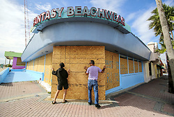September 9, 2017 - Daytona Beach, Florida, U.S. - Miroslava Roznovjakova, left, and her husband, Ray Hayyat, add some last minute pieces of wood protection to their storefront in preparation for Hurricane Irma. (Credit Image: © Jacob Langston/TNS via ZUMA Wire)