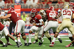Alabama Crimson Tide quarterback Jalen Hurts (2) carries the ball agains the Florida State Seminoles during the Chick-fil-A Kickoff NCAA football game on Saturday, September 2, 2017, in Atlanta. (Paul Abell via Abell Images for Chick-fil-A Kickoff Game)
