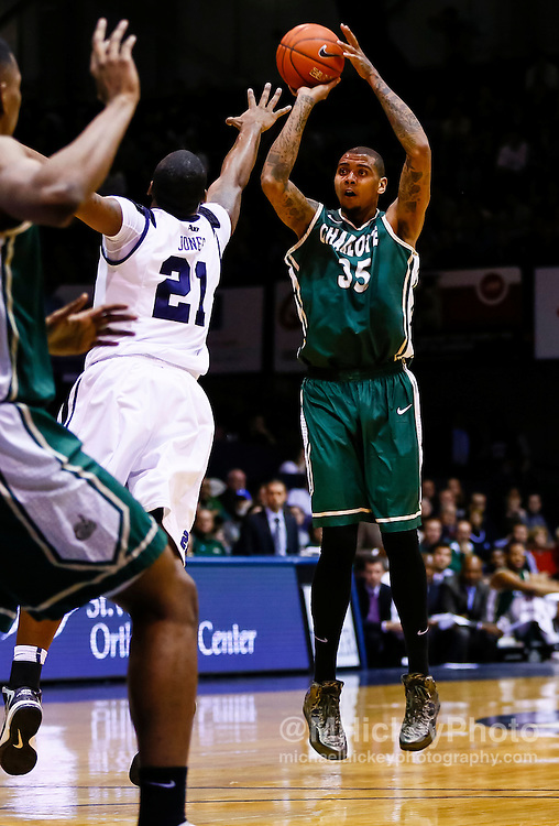 INDIANAPOLIS, IN - FEBRUARY 13: Chris Braswell #35 of the Charlotte 49ers shoots the ball against Roosevelt Jones #21 of the Butler Bulldogs at Hinkle Fieldhouse on February 13, 2013 in Indianapolis, Indiana. Charlotte defeated Butler 71-67. (Photo by Michael Hickey/Getty Images) *** Local Caption *** Chris Braswell; Roosevelt Jones