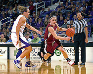 Santa Clara guard Chandice Cronk (R) drives around Kansas State's Kimberly Dietz (L) in the first half at Bramlage Coliseum in Manhattan, Kansas, December 15, 2006.  K-State defeated Santa Clara 76-52.<br />