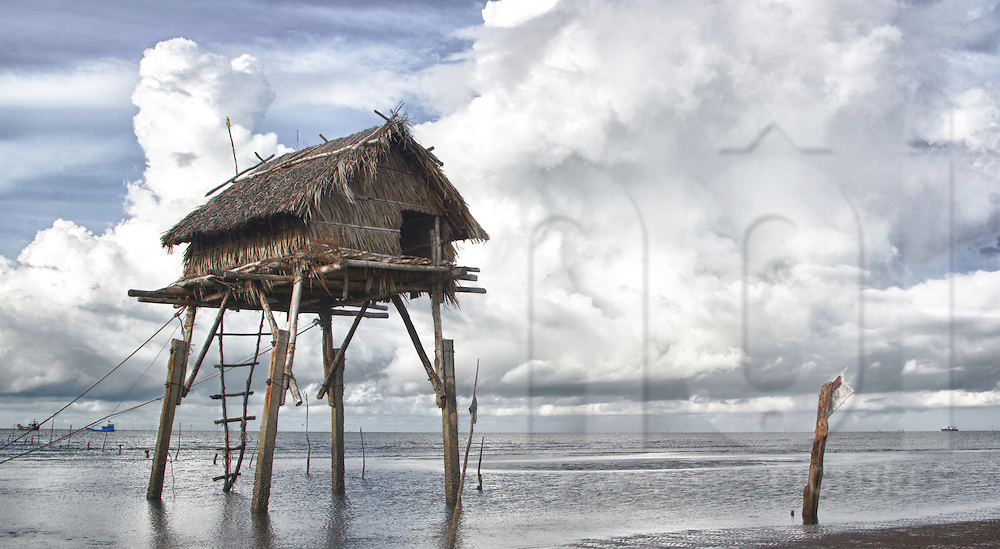 Shack on stilt along a beach in Can Gio, Vietnam, Southeast Asia