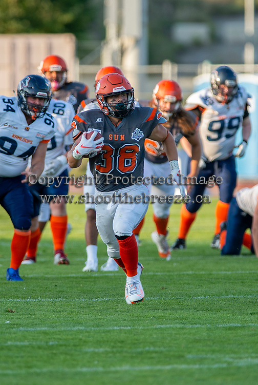 KELOWNA, BC - AUGUST 3:  Kelton Kouri #38 of Okanagan Sun runs with the ball against the Kamloops Broncos at the Apple Bowl on August 3, 2019 in Kelowna, Canada. (Photo by Marissa Baecker/Shoot the Breeze)