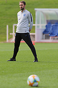 England Manager Gareth Southgate watches on during England's Euro 2020 Qualifier training session at St George's Park National Football Centre, Burton-Upon-Trent, United Kingdom on 23 March 2019.