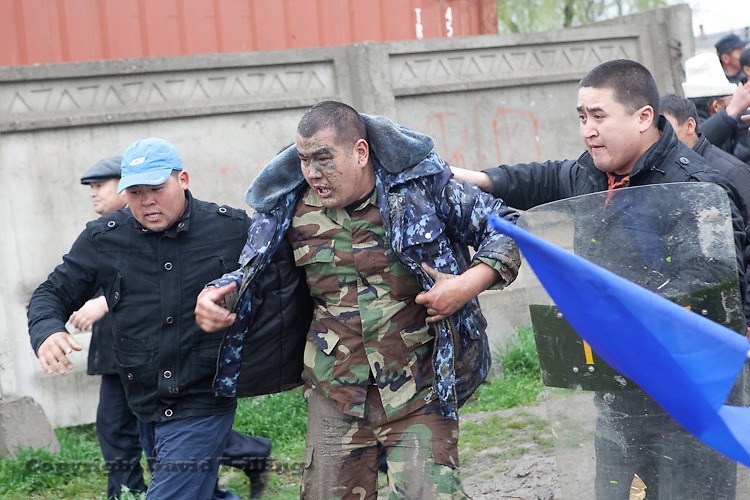 Calling for ouster of President Kurmanbek Bakiyev, rioters detained and beat police officers during an uprising in Bishkek, Kyrgyzstan on April 7, 2010.