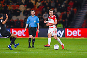 Herbie Kane of Doncaster Rovers (15) passes the ball during the EFL Sky Bet League 1 match between Doncaster Rovers and Barnsley at the Keepmoat Stadium, Doncaster, England on 15 March 2019.