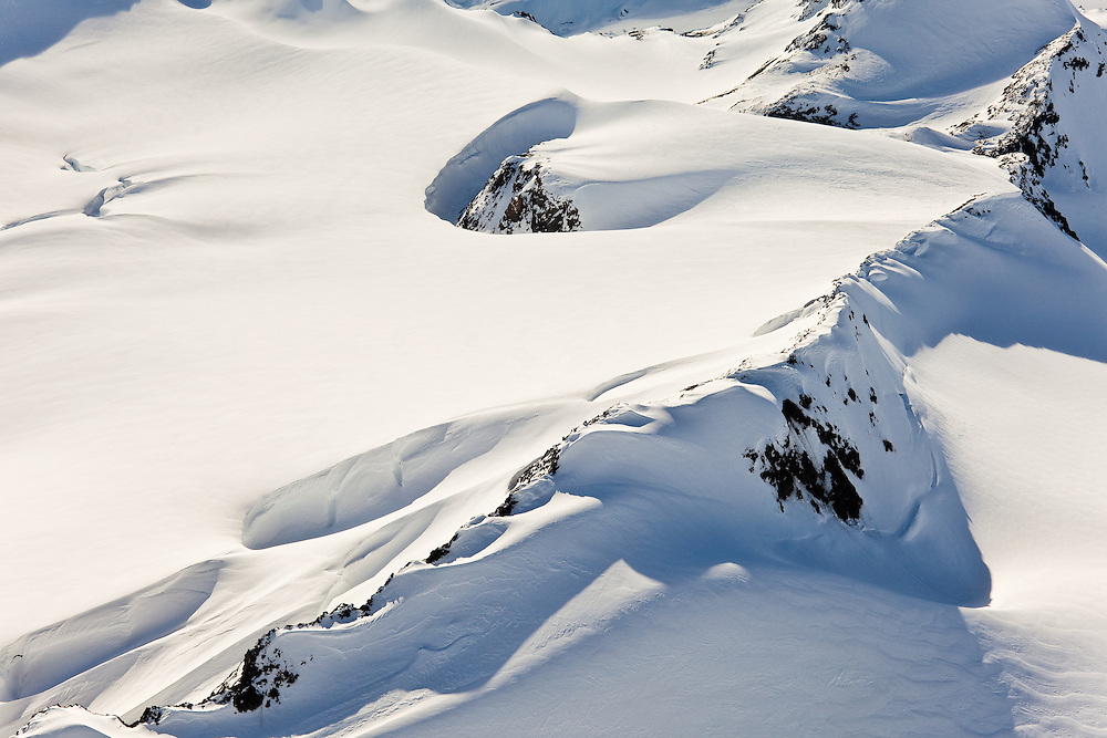 Deep snow layers over the underlying icecap of the Chugach Mountains in Chugach State Park near Anchorage in Southcentral Alaska. Spring. Morning.