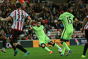 Manchester City forward Sergio Aguero with a shot during the Capital One Cup match between Sunderland and Manchester City at the Stadium Of Light, Sunderland, England on 22 September 2015. Photo by Simon Davies.