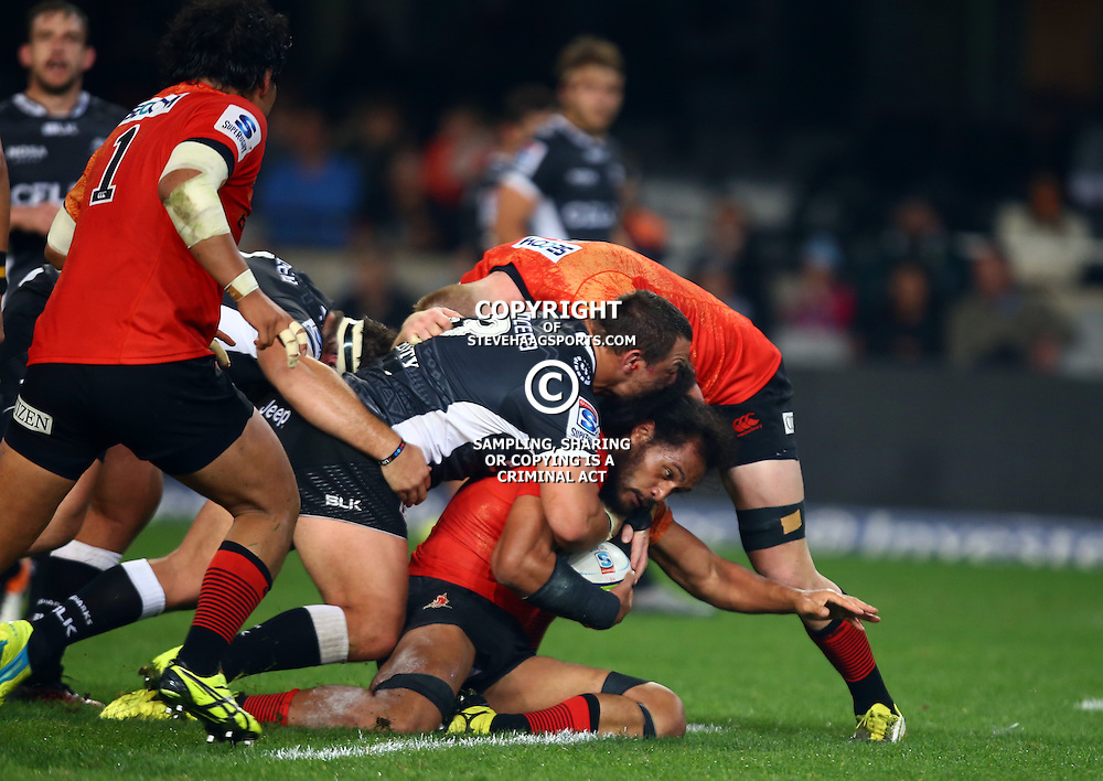 DURBAN, SOUTH AFRICA - JULY 15: Coenie Oosthuizen of the Cell C Sharks tackling Liaki Moli of the Sunwolves during the Super Rugby match between the Cell C Sharks and Sunwolves at Growthpoint Kings Park on July 15, 2016 in Durban, South Africa. (Photo by Steve Haag/Gallo Images)