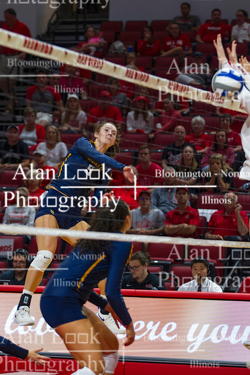 BLOOMINGTON, IL - September 15: Kaitlyn Lines strikes the ball at a pair of Redbird blockers during a college Women's volleyball match between the ISU Redbirds and the Marquette Golden Eagles on September 15 2019 at Illinois State University in Normal, IL. (Photo by Alan Look)