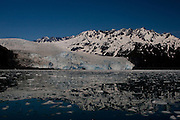Aialik Glacier, Kenai Fjords National Park, Alaska. This is one glacier that isn't receding quickly. Instead, it still flows right into the tranquil waters of Aialik Bay, Alaska.