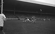 All Ireland Minor Football Final Kerry v. Westmeath, Croke Park..A dangerous moment for Kerry defenders, Behan and McCarthy, as Westmeath forward Coffey breaks through..22.09.1963