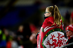 A Wales fan with a flag wrapped around her shoulders - Mandatory by-line: Ryan Hiscott/JMP - 13/10/2019 - FOOTBALL - Cardiff City Stadium - Cardiff, Wales - Wales v Croatia - UEFA European Qualifiers