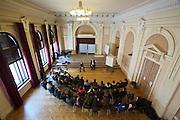 """Vienna, Brigittenauer Gymnasium (Festsaal). Discussion with students and Gregor Mayer (r.) and Bernhard Odehnal, the authors of the book """"Aufmarsch: Die rechte Gefahr aus Osteuropa""""."""