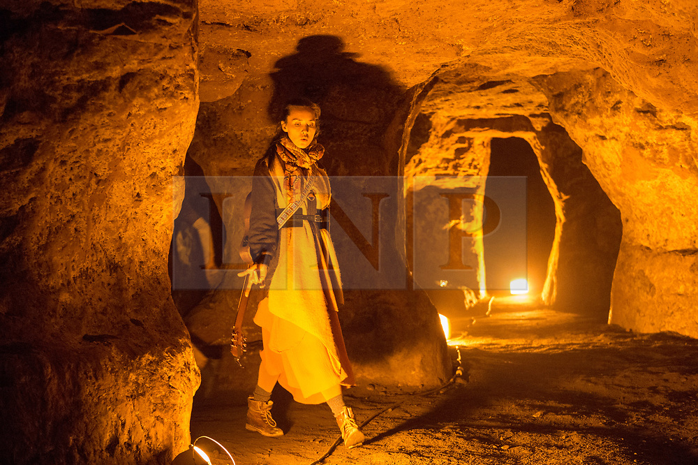 © Licensed to London News Pictures.  21/07/2018; Bristol, UK. Bristol Harbour Festival. Performance in Redcliffe Caves of Beneath Our Feet, performed by Made by Katie Green dance company. Performer Katie Green gathers together willing audiences for an extraordinary expedition into one of Bristol's hidden and normally closed spaces.<br /> Created in collaboration with archaeologists, geologists, historians, cavers and former miners, Beneath Our Feet is a promenade performance using dance and live music to tell the story of the underground. Bristol Harbour Festival is a 3 day extravaganza of dance, music, theatre, circus, ships and boats, arts and delicious food. The festival is free for all and brings over 250,000 people together each summer to celebrate Bristol's rich maritime history and enjoy some of the city's best music and entertainment. The festival takes place on the  20 - 22 July 2018. Photo credit: Simon Chapman/LNP