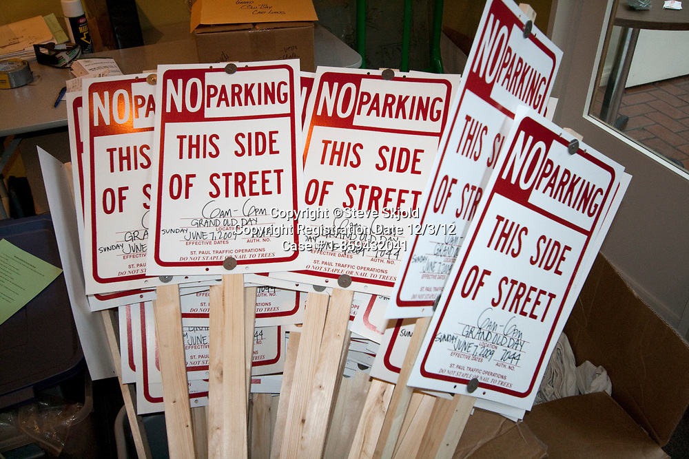 Bundle of No Parking signs for Grand Old Day street fair. St Paul Minnesota MN USA