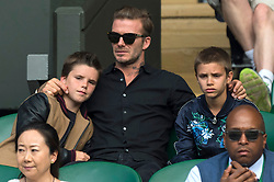 © Licensed to London News Pictures. FILE PICTURE. 06/07/2016. CRUZ BECKHAM, DAVID BECKHAM, and ROMEO BECKHAM watch tennis on the centre court on the tenth day of the WIMBLEDON Lawn Tennis Championships. Bookmakers have suspended bets on the Beckham's getting a divorce. Photo credit: Ray Tang/LNP
