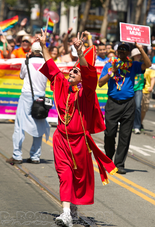 A San Franciscan who identified himself as Tony waves to the crowd at the 43rd annual San Francisco Pride parade, Sunday, June 30, 2013 in San Francisco. (Photo by D. Ross Cameron)