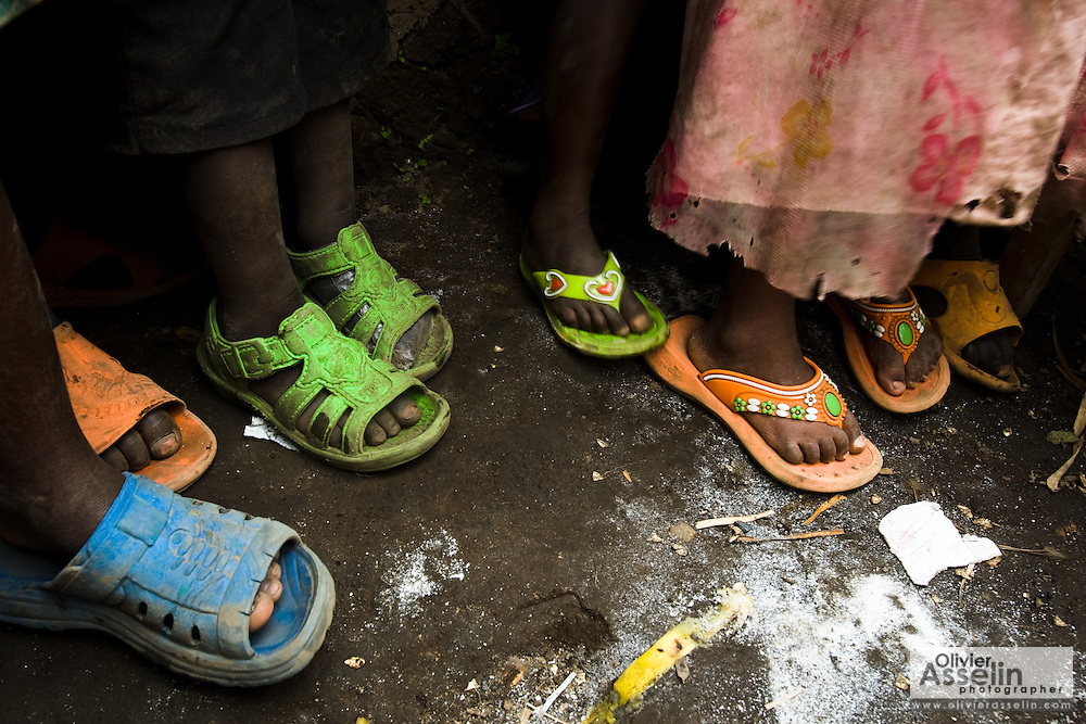 Children wearing sandals at the Shasha IDP site near the town of Shasha, 23km south-west of Goma, Eastern Democratic Republic of Congo on Friday December 12, 2008.