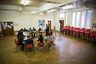 A teacher with a class of students being taught basic English at Befriending Refugees and Asylum Seekers (BRASS) in Bolton, Greater Manchester, northwest England. The project was established in 2001 and run by Bolton Methodist Mission as a drop-in centre for asylum seekers, refugees and refused asylum seekers.